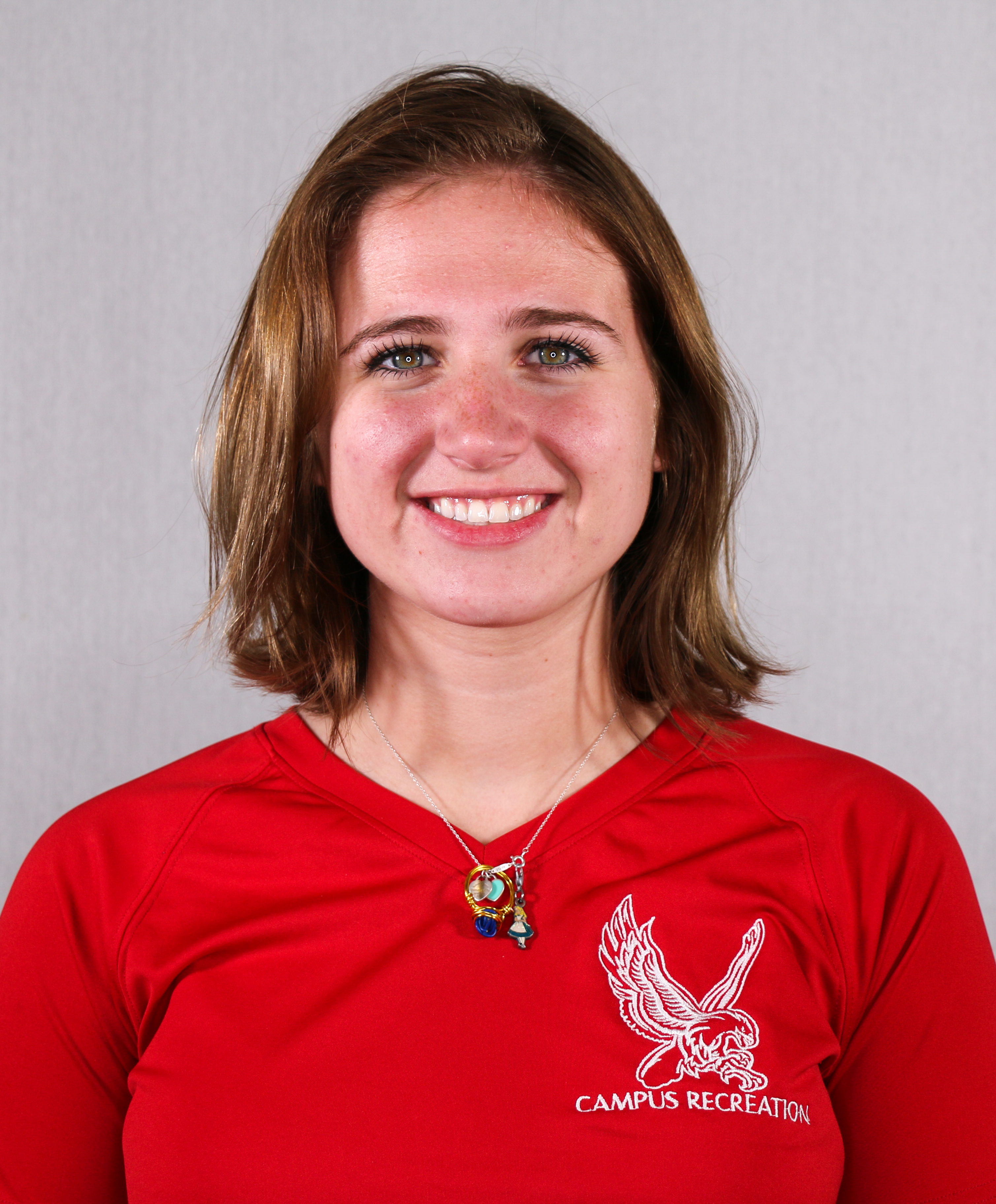 Headshot of Alexis Gross wearing a red Campus Recreation t-shirt.