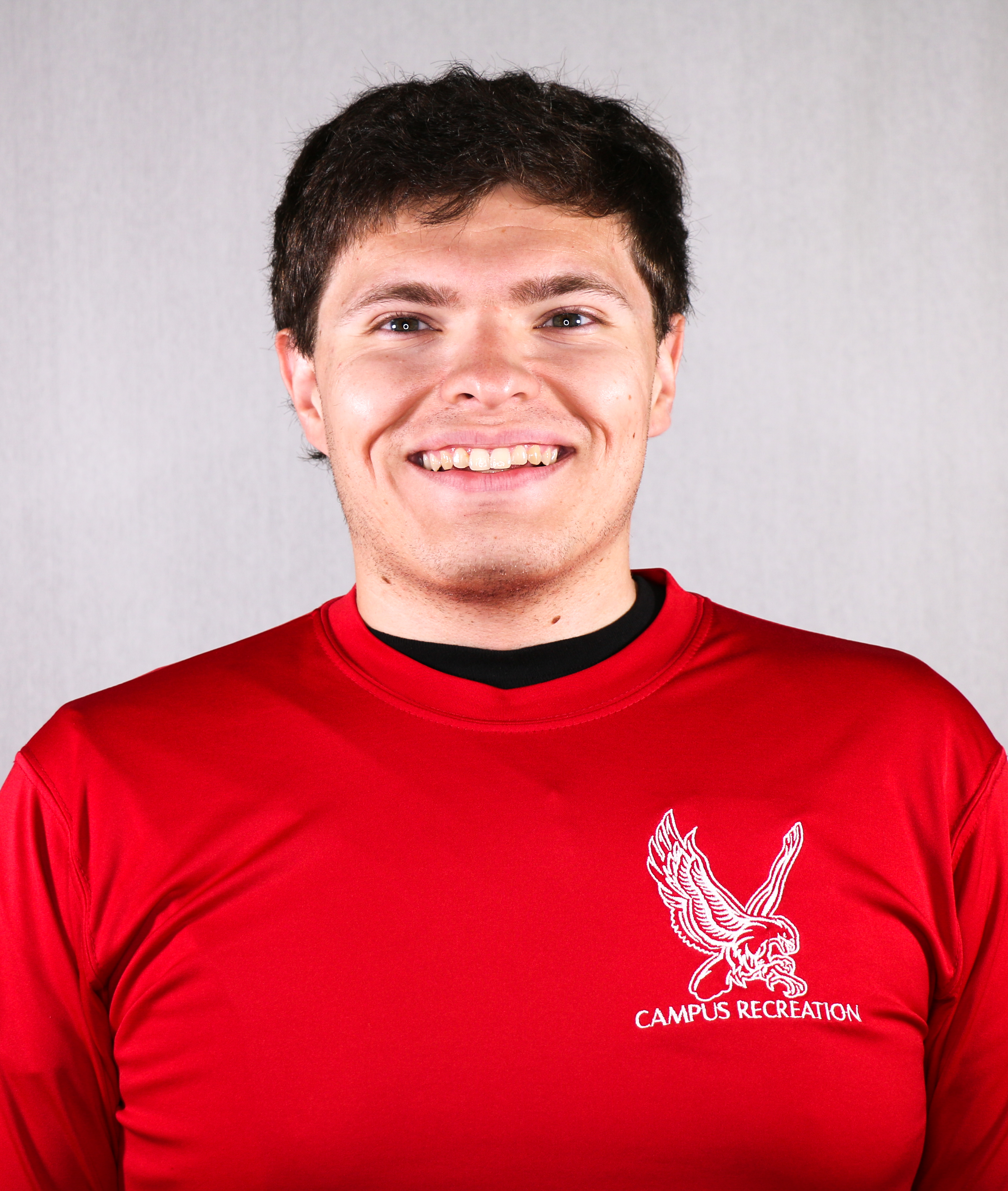 Headshot of Brandon Marques wearing a red Campus Recreation t-shirt.