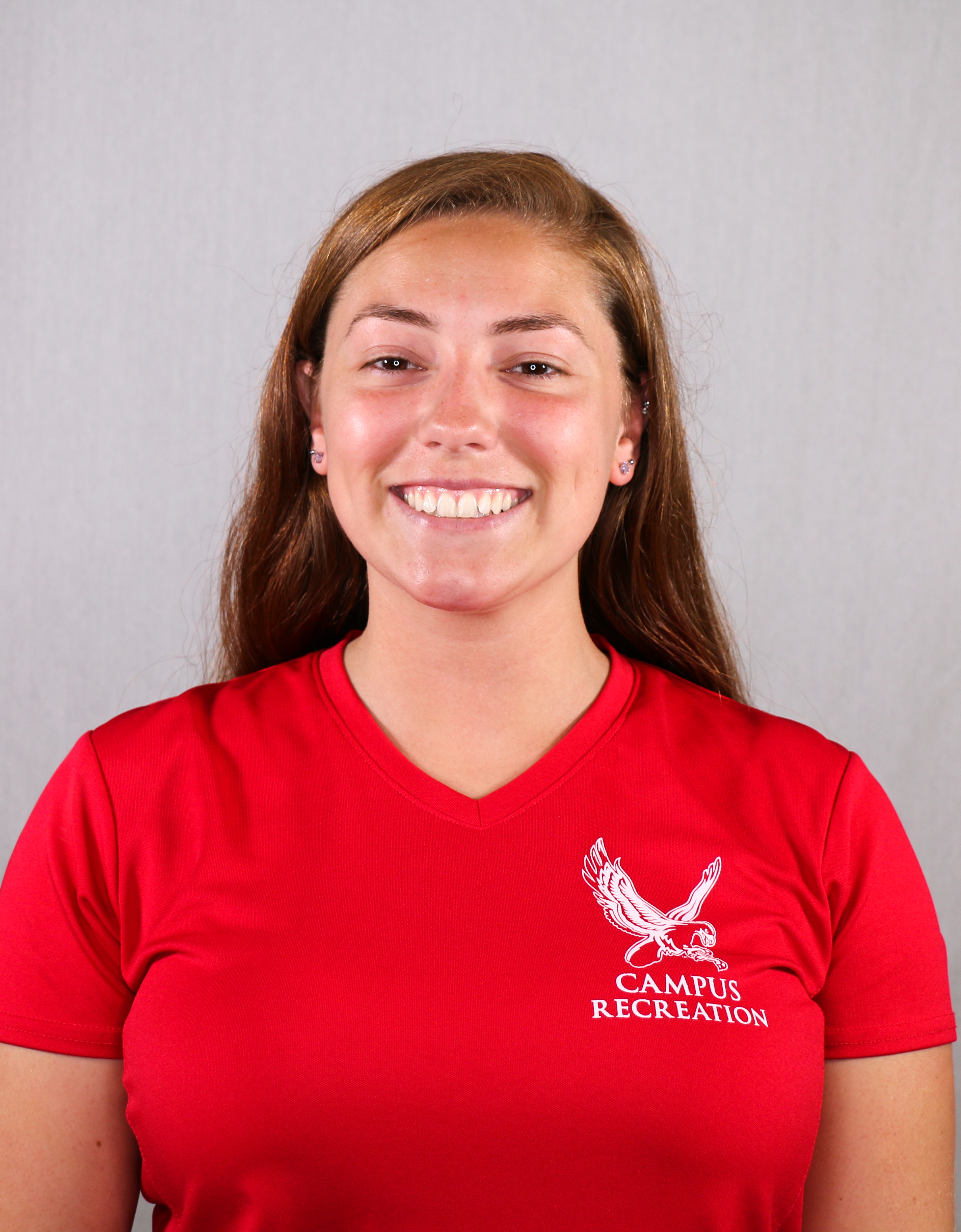 Headshot of Flo Coccoz wearing a red Campus Recreation t-shirt.