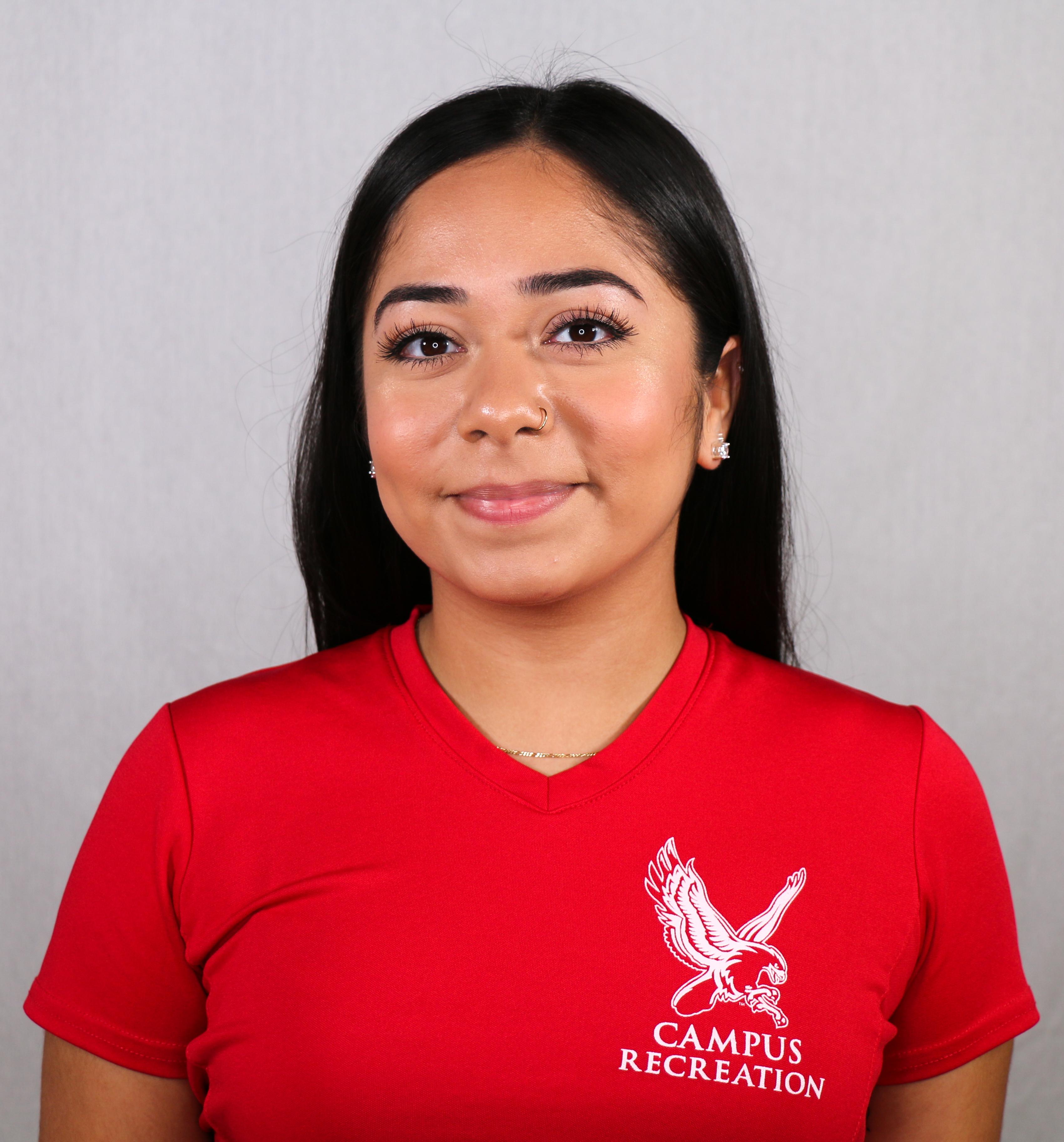 Headshot of Jaela Garcia wearing a red Campus Recreation t-shirt.