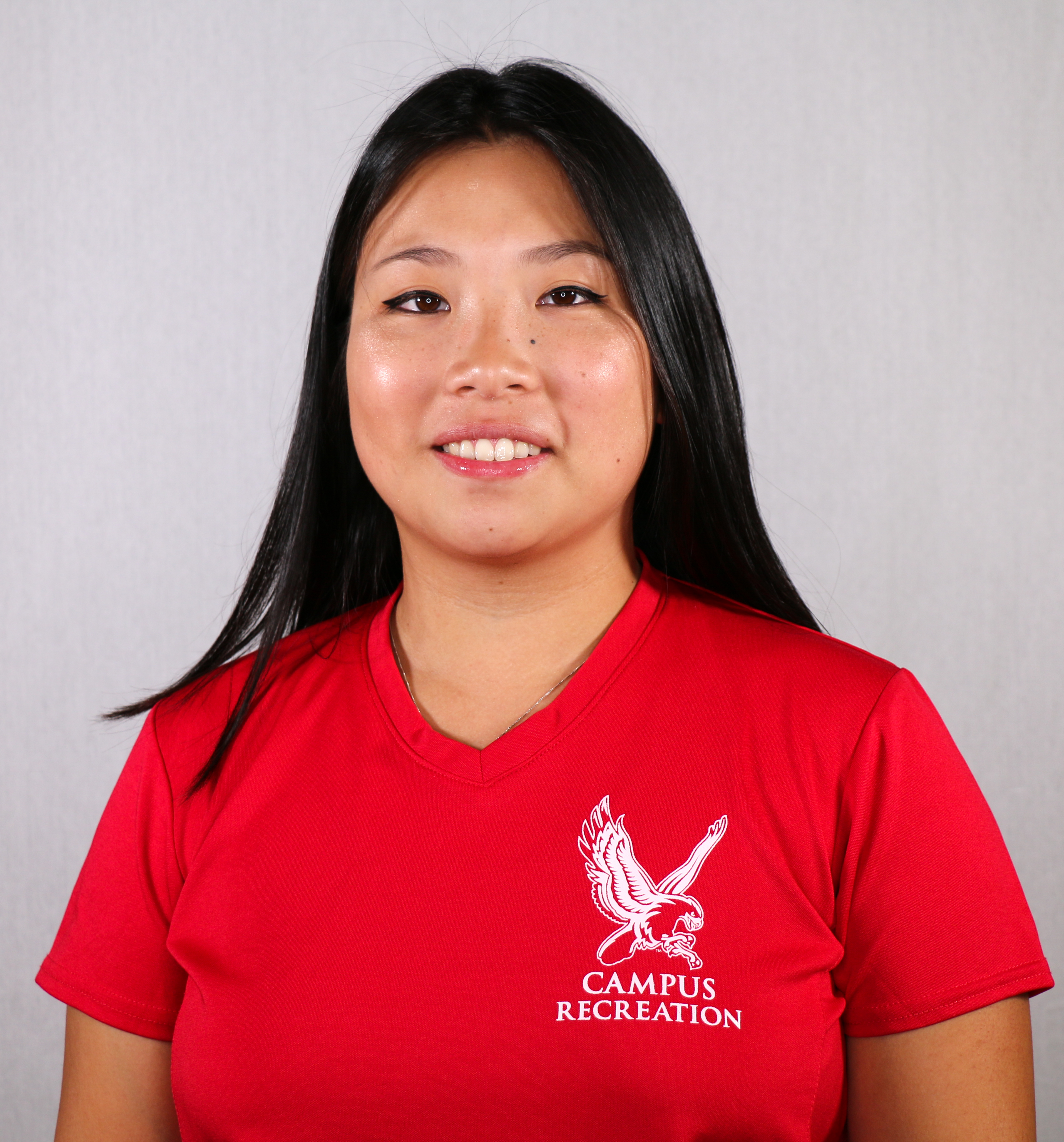 Headshot of Linda Mozdzen wearing a red Campus Recreation t-shirt.