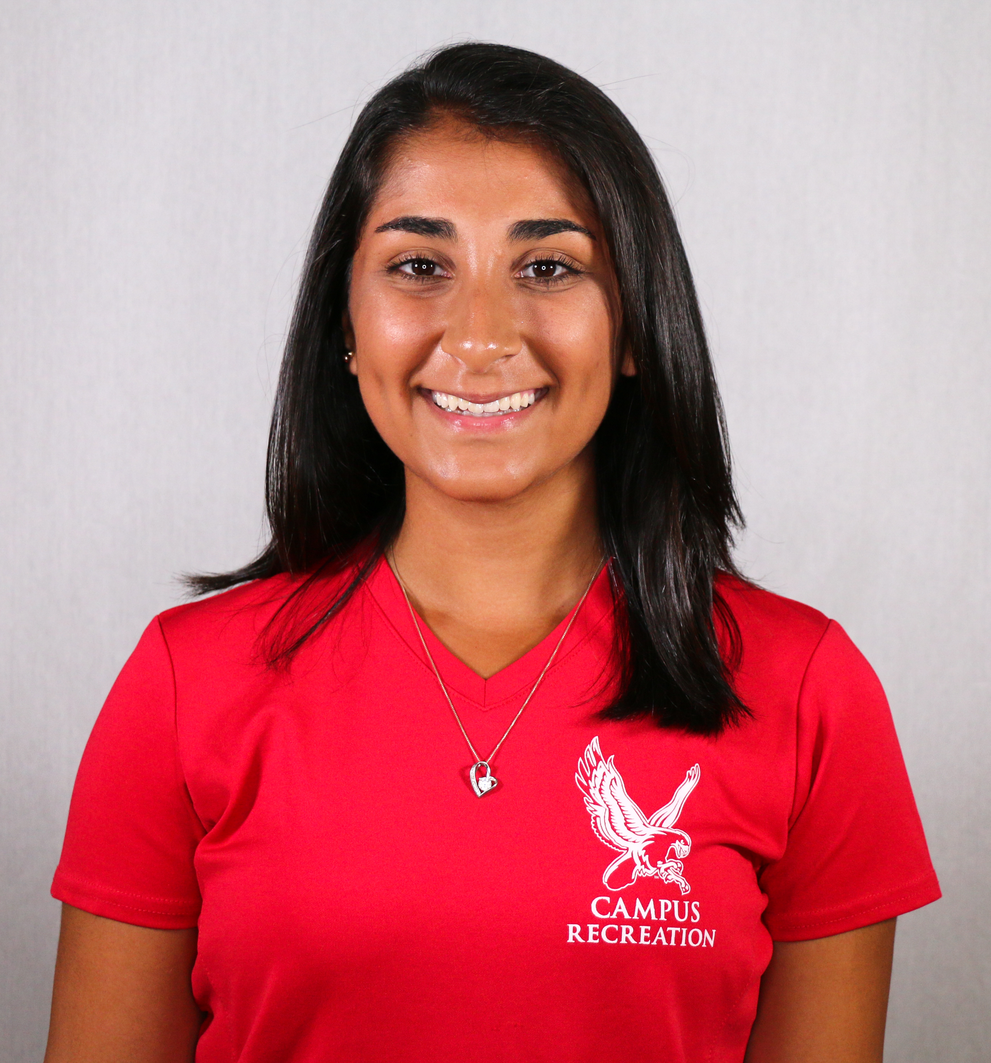 Headshot of Rachel DeFelice wearing a red, Campus Recreation t-shirt.