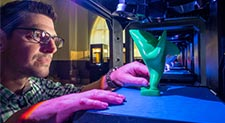 Photo of Jason Frasca at 3d Printer.