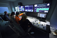 Photo of Montclair State students in studio control room.