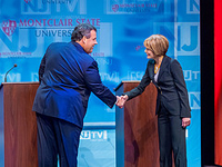 Christie and Buono shake hands before debate.