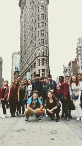 Photo of students in front of the Flatiron building in Manhattan, NY.