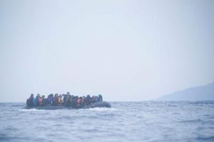 An image of refugees on a boat crossing the Mediterranean