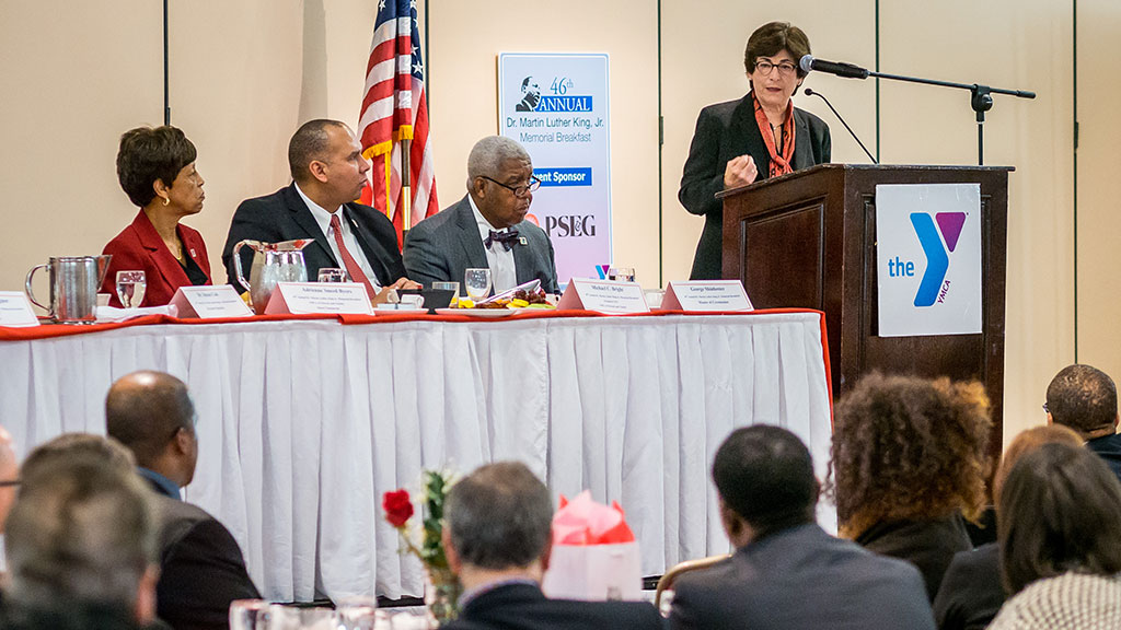 Photo of President Susan A. Cole addressing guests at MLK breakfast.