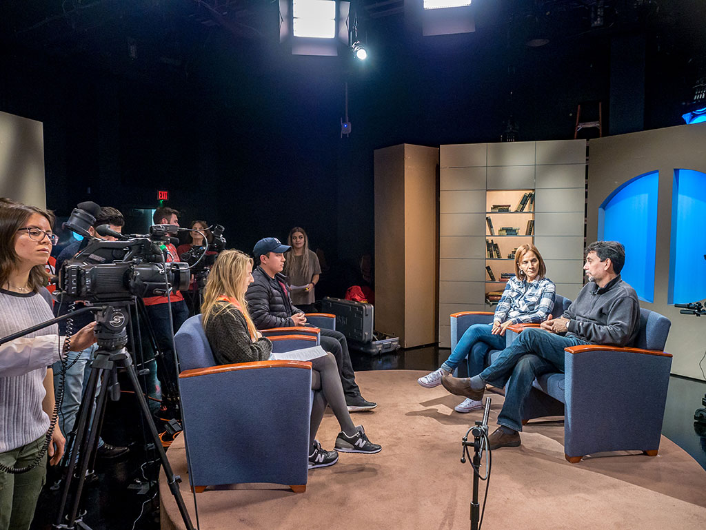 Cuban Filmmakers Diana Rosa Pérez Legón and Jorge Luis Santana Pérez were interviewed by students Nathalie Tilley and Christian Guaman (seated), and camera operator Kristie Keleshian and other students at the studios at Montclair State.