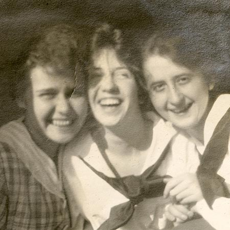 Three women smiling for photo in 1918.
