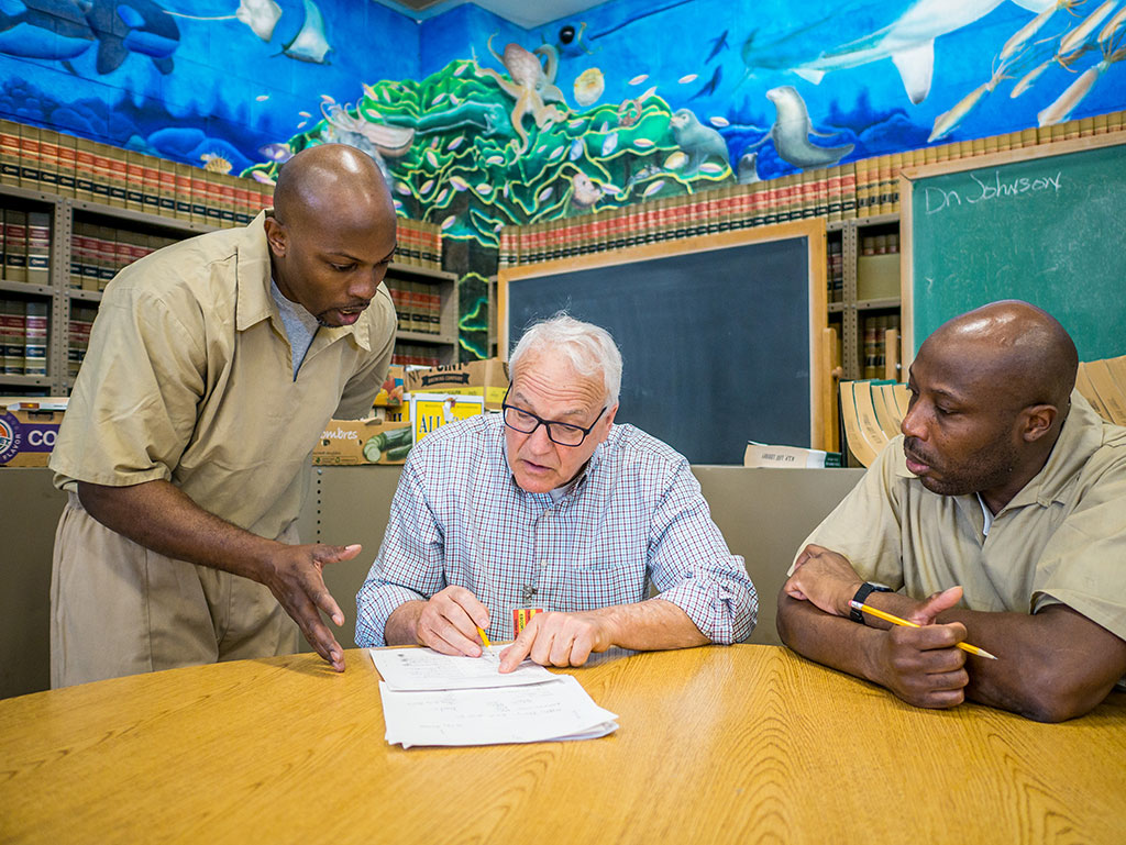 Prison teaching assistant Kevin McCray Montclair State adjunct Alan Lentin help inmate Oneil Reid hone his writing skills.