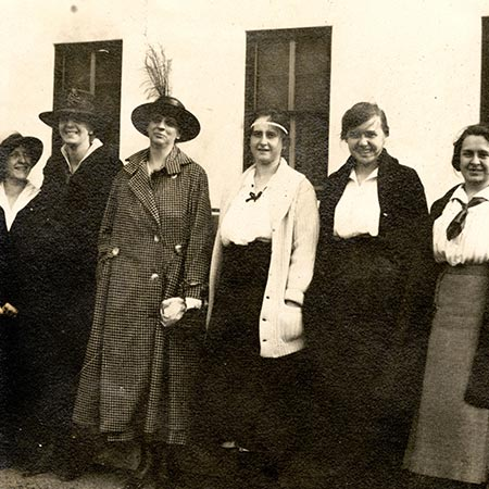 Six women standing in front of Russ Hall in 1918.