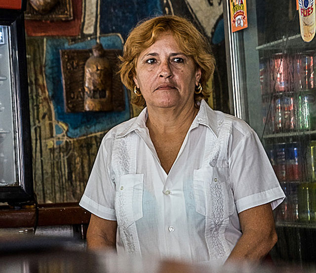 A woman in a store in Cuba.