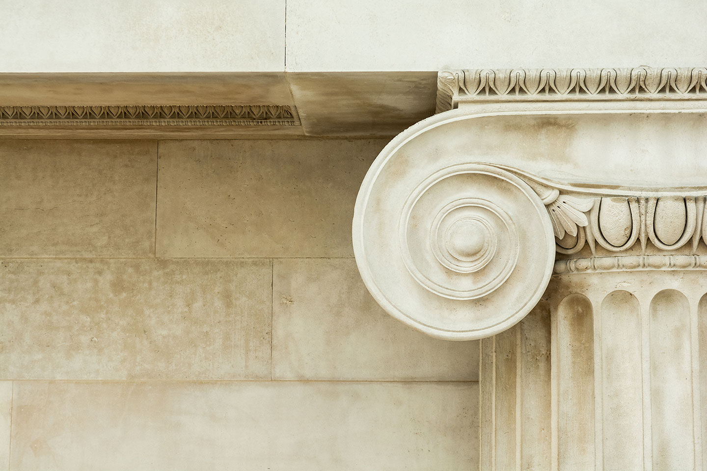 Close-up of the top of a marble column.