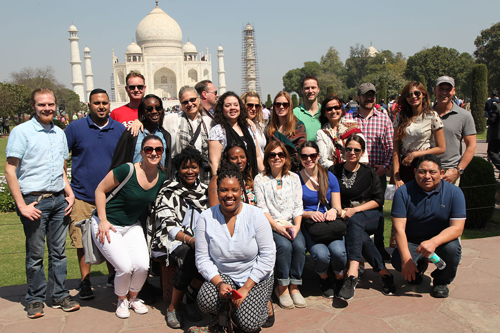 Feliciano School of Business MBA students posing in India in front of the Taj Mahal.