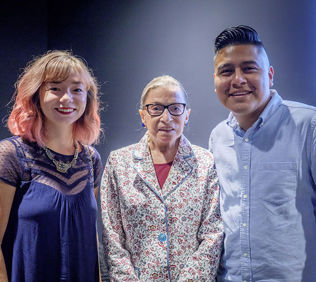 Ginsburg poses with recent graduates Allison Gormley and Gustavo Vasquez.