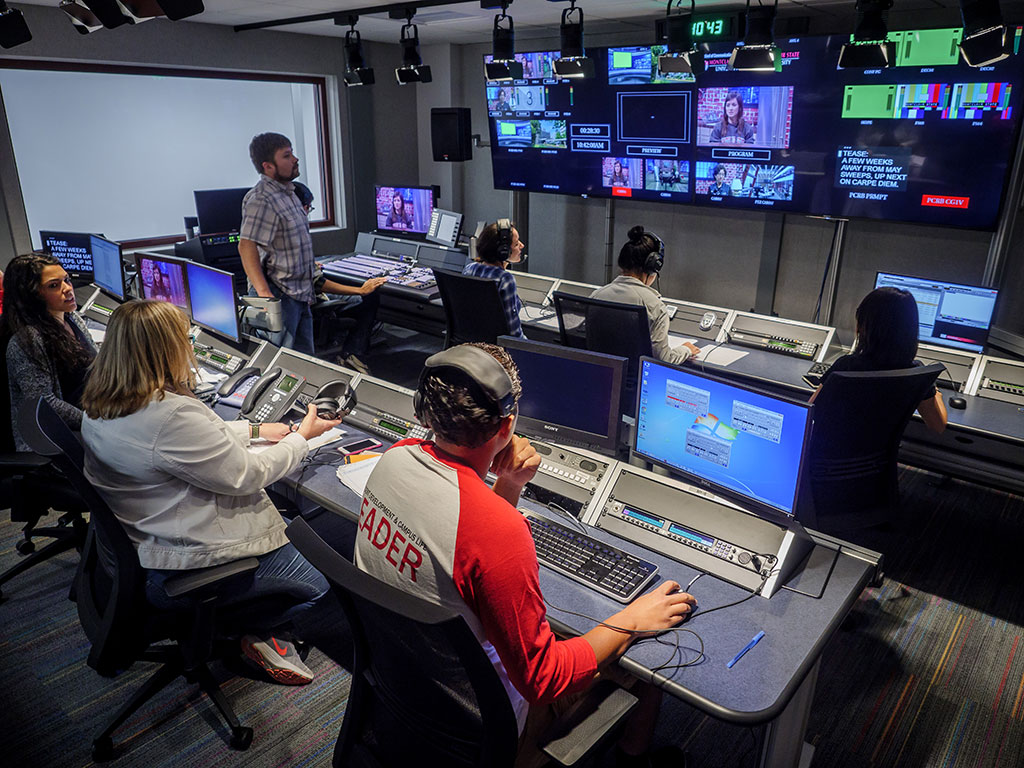 Students work in a broadcast control room to produce Carpe Diem.