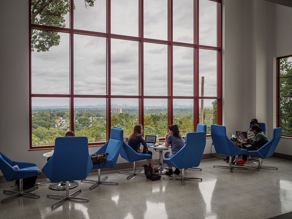 Students enjoying the common space of the new School of Communication and Media building.