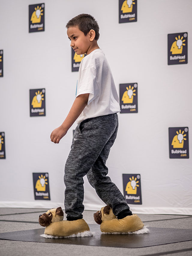 Neatsweeps rolls out the cute factor with Tanim, 8, demonstrating the house-cleaning slippers during the pitch.