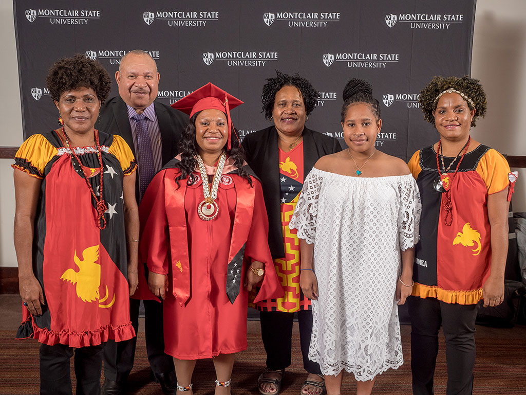 Political leaders and family traveled from Papua New Guinea to see Fulbright Scholar Rose Andrew receive a Master of Public Health. From left, front, Jennifer Makiba, Rose Andrew, Kikitani Andagali, Rhonda Andrew Kelwaip Liu; in back, Larry Libe Andagali and Janet Andagali