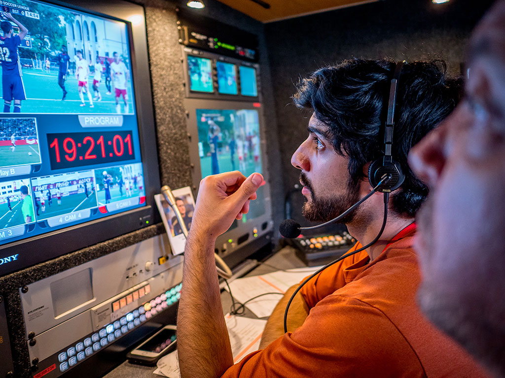 Christo Apostolou '17 directs the Red Bulls II soccer broadcast from inside a mobile studio truck.