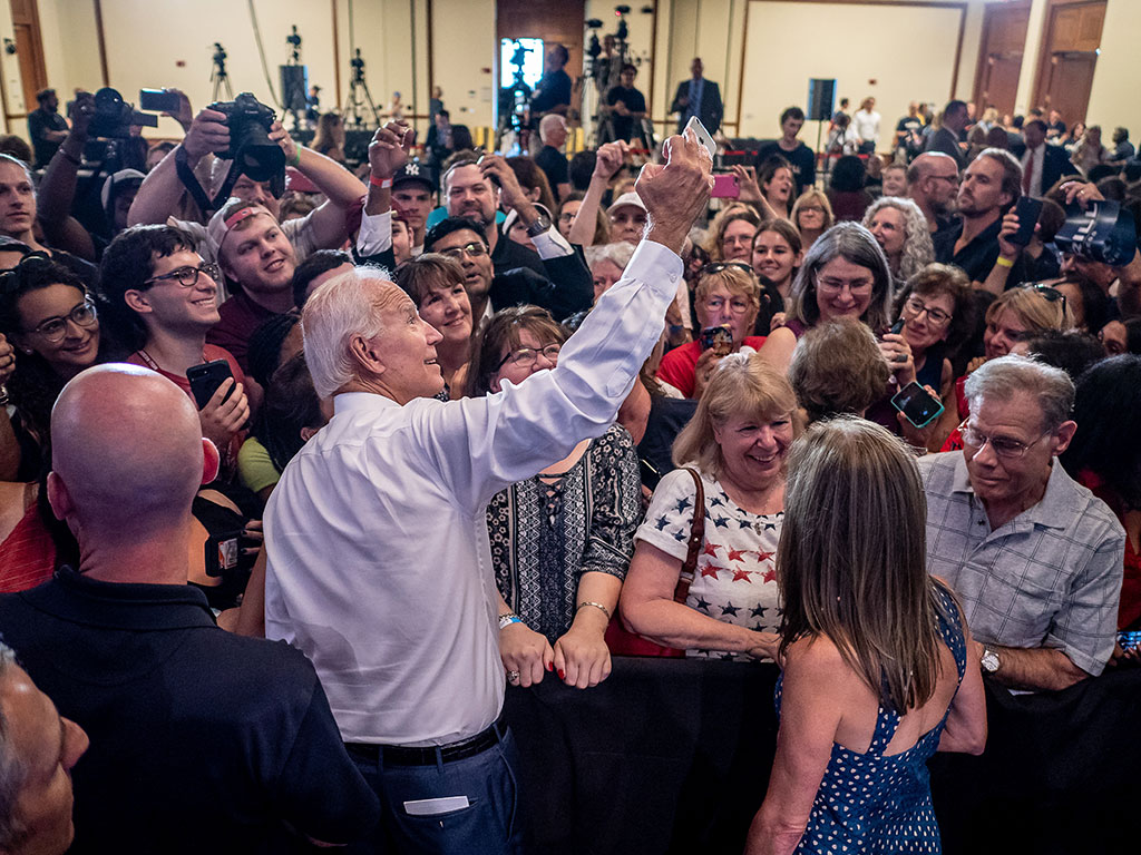 Vice President Joe Biden takes a selfie with students and fans