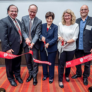 Alumnus Anthony Scriffignano '82, '85 MA and University board member Francis Cuss join Susan A. Cole, Lora Billings and Constantine Coutras at the opening