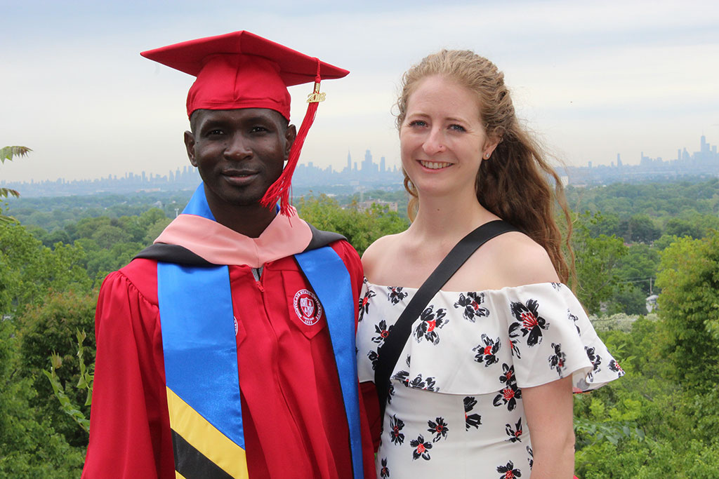 Adrienne Strong, who is conducting research in Tanzania, encouraged Samwel Marwa to come to America to earn the Master of Public Health as a Fulbright Scholar. She returned to the U.S. for his graduation.