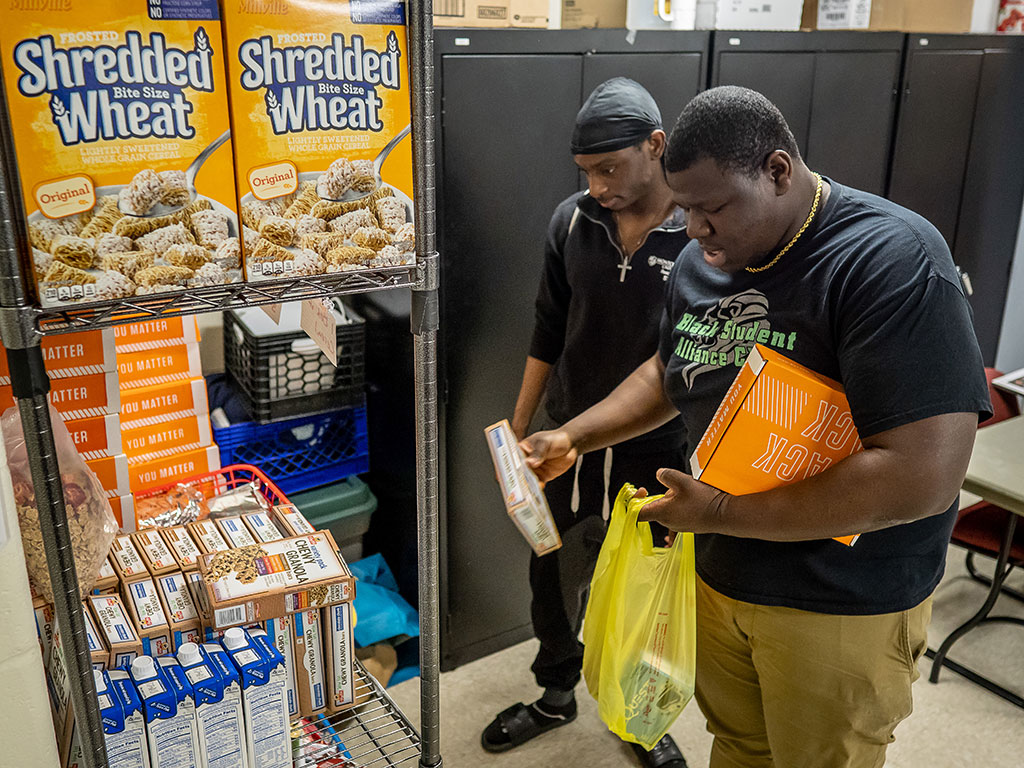Jerry Comprendre Jr. and Jean Pepe say the pantry has helped them succeed in school.