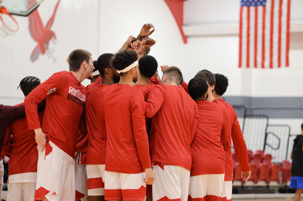 The Red Hawks huddle up before a big win.