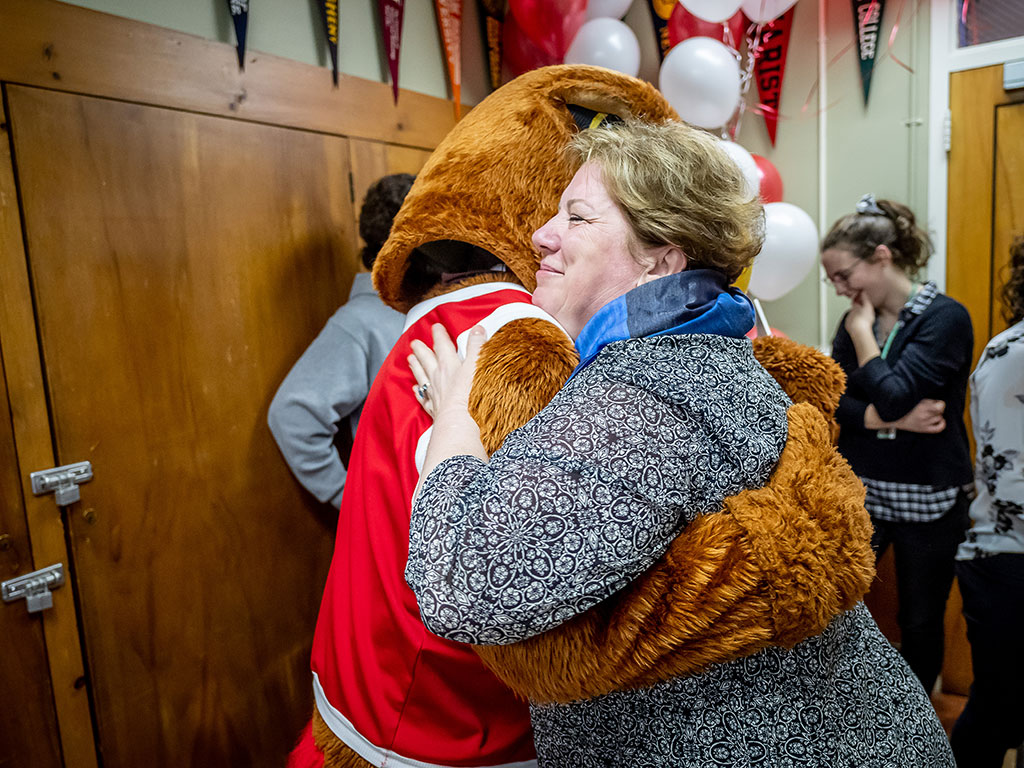 Silvia Povolo hugs Rocky at Montclair State's surprise reveal of the admissions offer for her quintuplets.