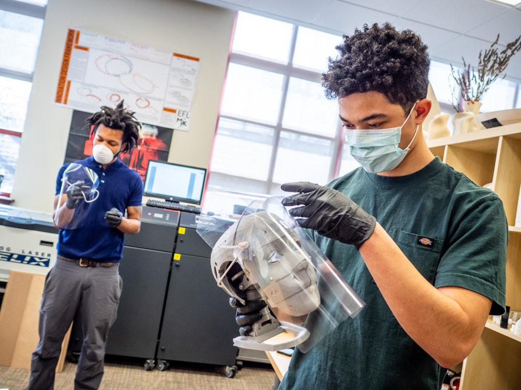 Alex McDonald tests a face shield design at Montclair State's MIX Lab.