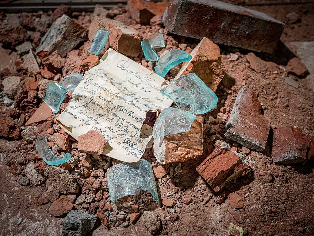 Letter surrounded by broken glass