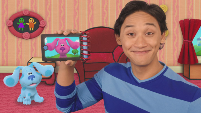 Josh De La Cruz holding up device with Blues Clues on screen