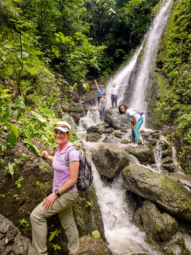 Associate Professor Jennifer Krumins at a Galápagos waterfall during the research trip in early March with Montclair State biology students in the days before social distancing. Shown are Ann Muthee, Stephanie Getto, Alorah Bliese and Siena Stucki.