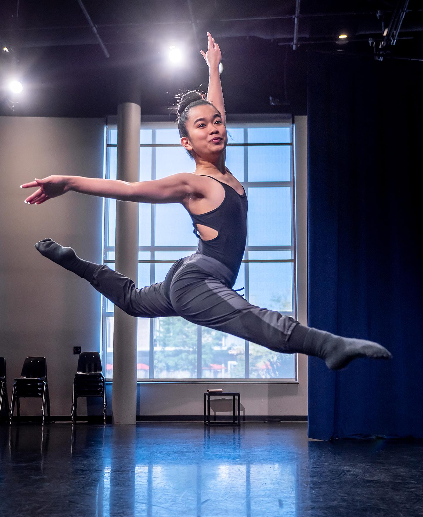Nicole Arakaki leaping in the air
