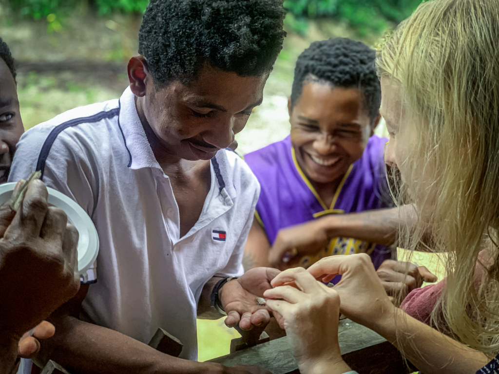 """Borgerson shares sakondry aka """"bacon bugs"""" with villagers in Madagascar."""