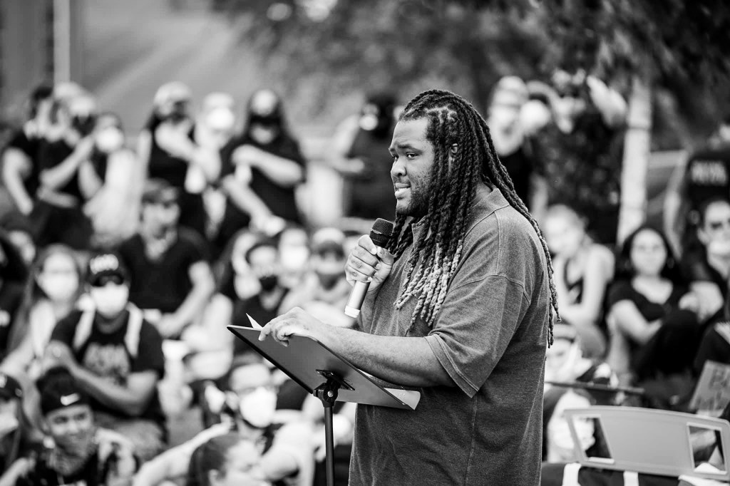 Jason Williams, assistant professor of Justice Studies, speaks at a demonstration in Wayne, New Jersey. Photo by Neil van Niekerk