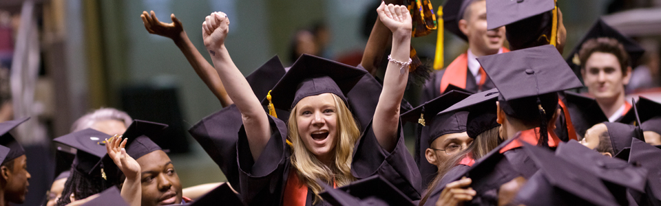 happy graduate at commencement