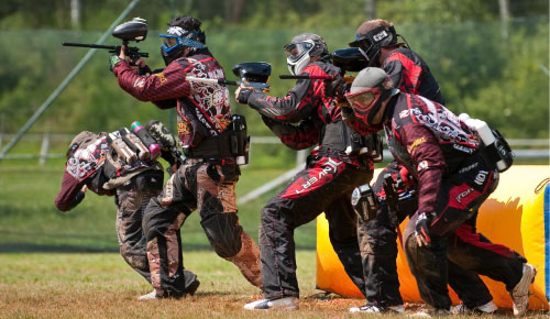 Picture of people playing paintball.