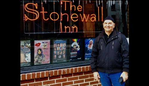 Picture of John-Manuel Andriote standing outside the Stonewall Inn.