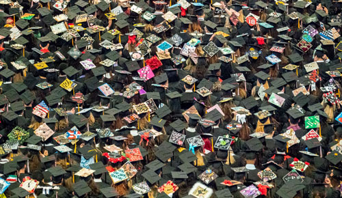Aerial picture of the caps of seated graduates at Commencement.