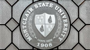 Photo of University seal in frosted glass in College Hall.