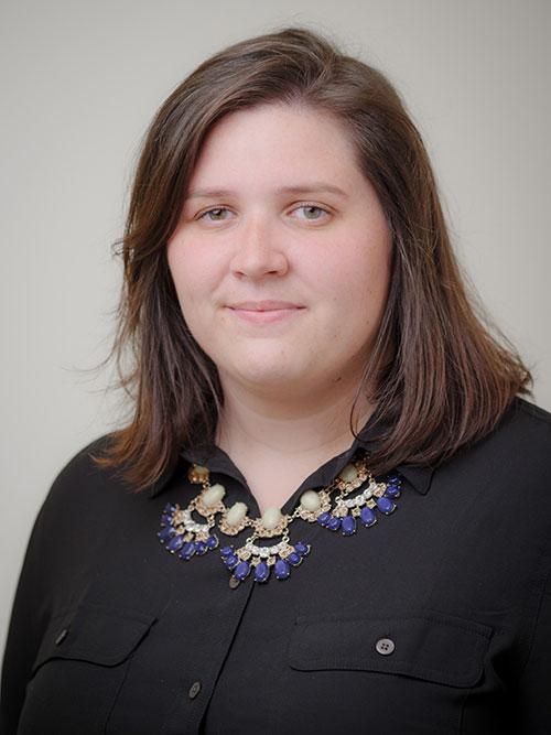 Headshot of Caitlin Babcock.