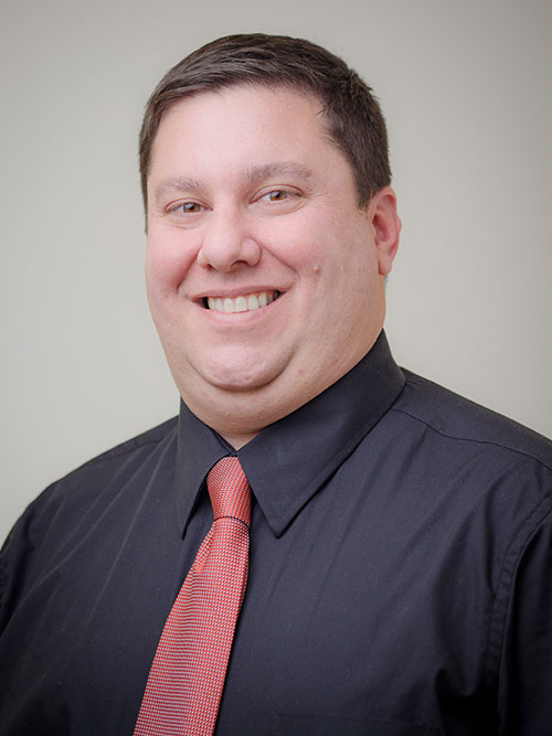 Headshot of Kevin Schafer.