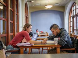 Two students studying in University Hall.