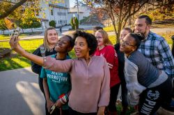 Photo of a group of students taking a selfie.