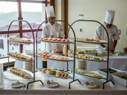 Photo of chefs in white hats catering an event.