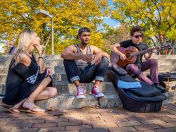 Photo of students playing guitar on main quad