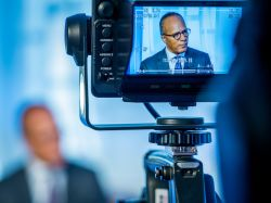 Photo of Lester Holt through camera viewfinder.